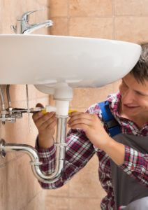 men_fixing_clogged_bathroom_sink.png