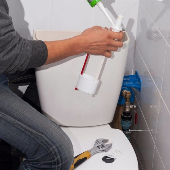 men_fixing_toilet_bowl_with_silicone.jpeg