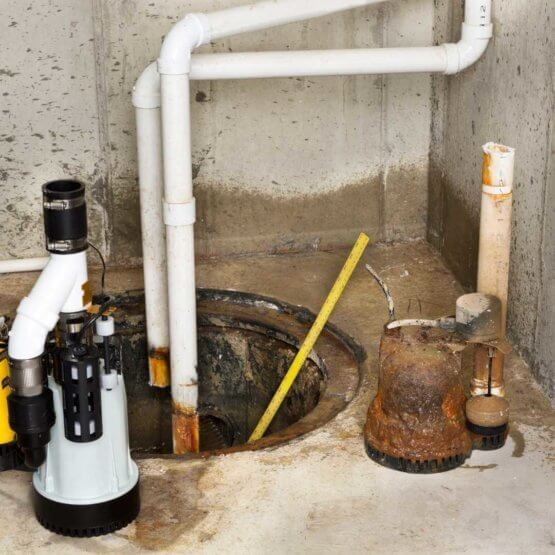 old_and_new_sump_pump.jpeg