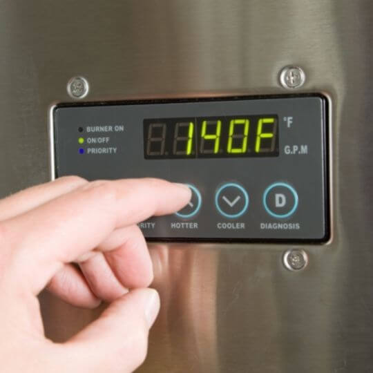 men_clicking_on_digital_tankless_water_heater_thermometer.jpeg